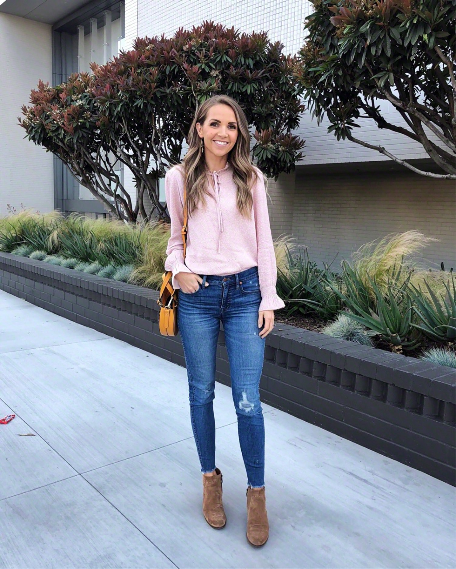 pink sweatshirt and jeans