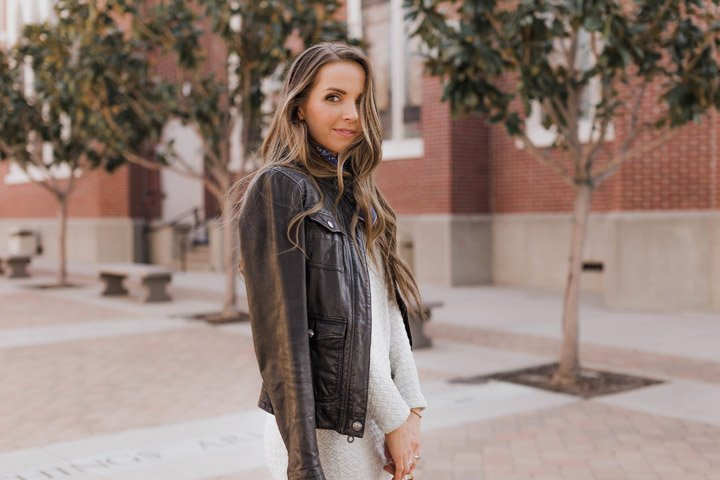 black leather jacket and gray midi dress
