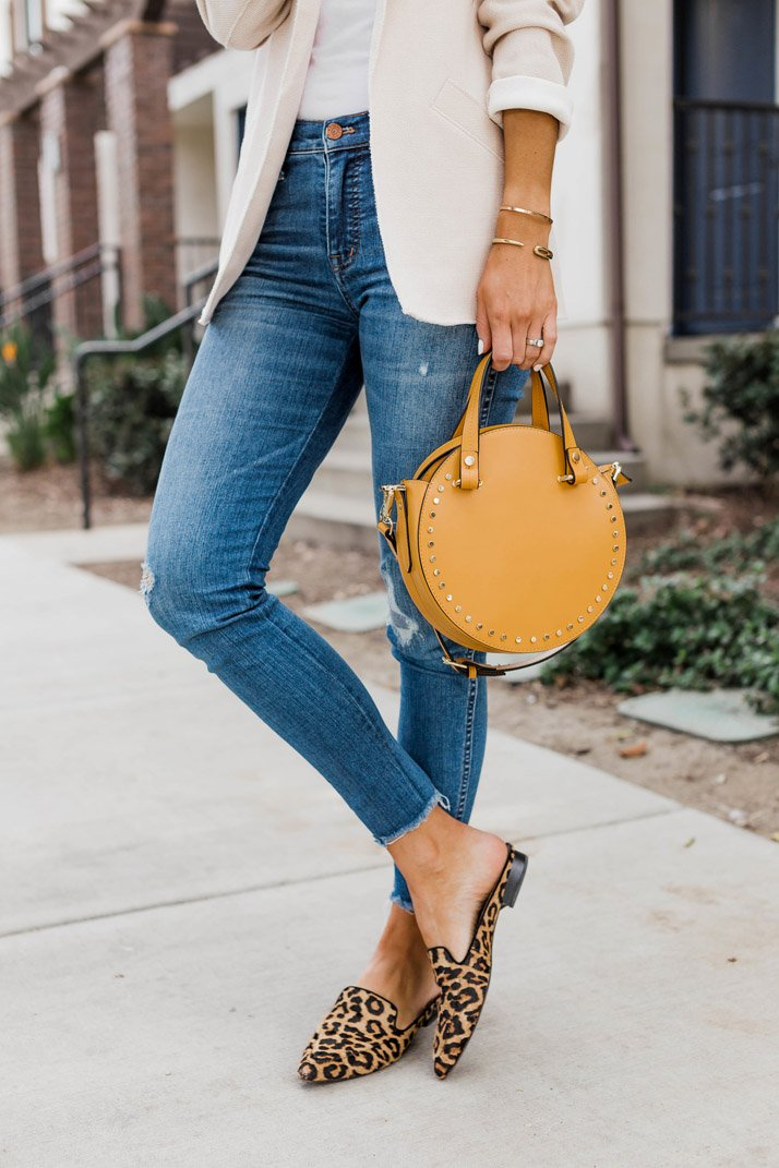 leopard mules and blue jeans