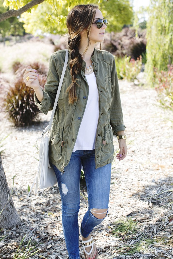 white tee with olive jacket and jeans