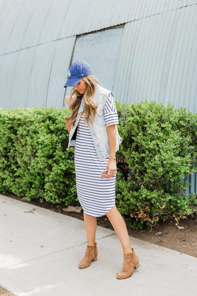 striped dress and baseball cap