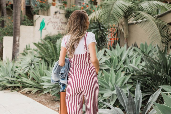 toss a white tee under a jumpsuit!
