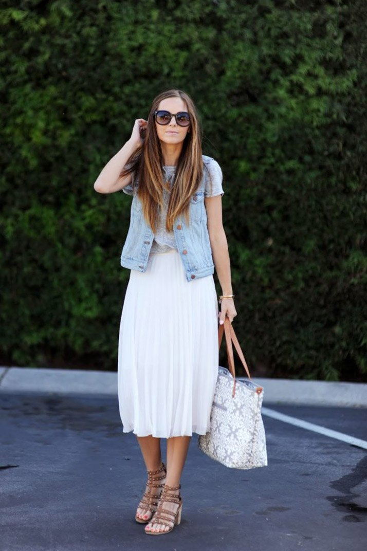 bd4125e0abb9 add a denim vest to your midi skirt for a chic and simple look
