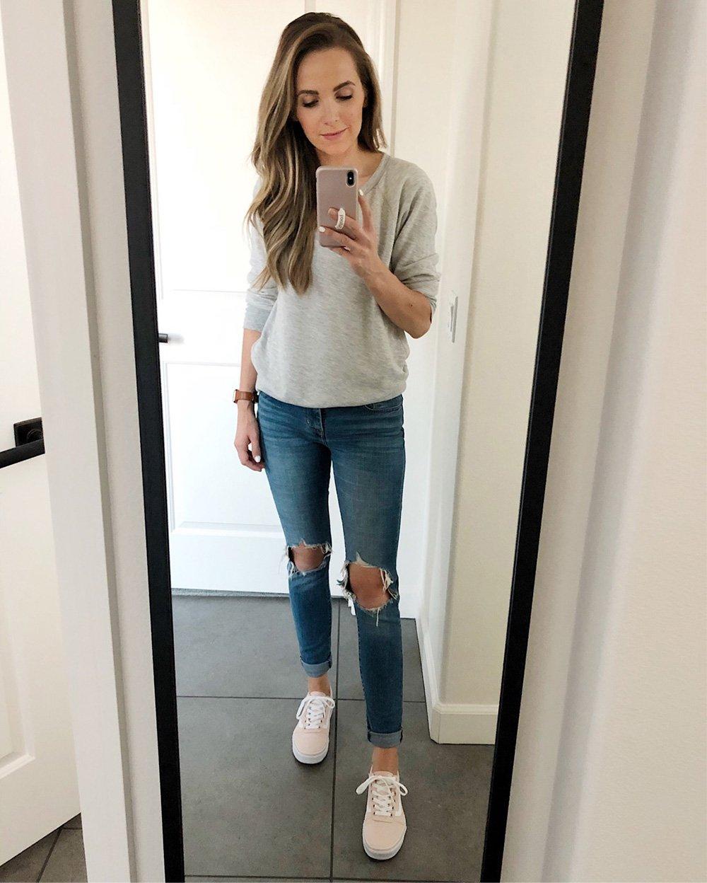 grey sweatshirt and jeans