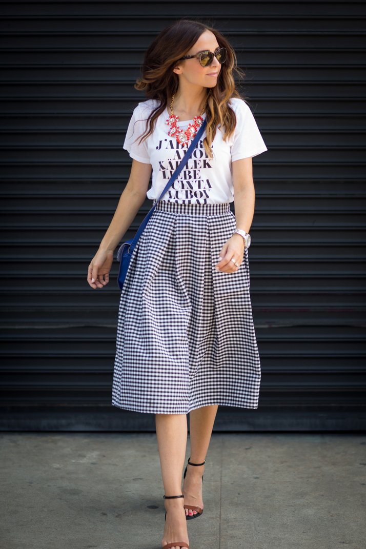 tuck your graphic tee into a midi skirt for a fun, easy look