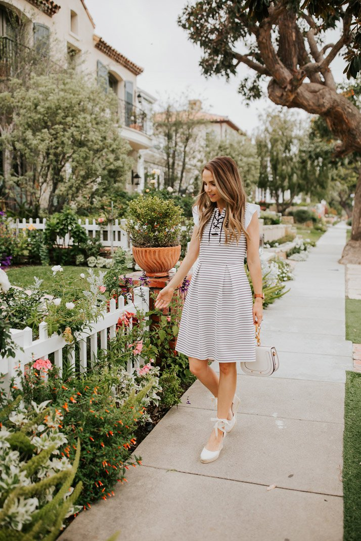 this cute striped dress would be perfect for a spring wedding, but also church or date night or almost any other occasion!