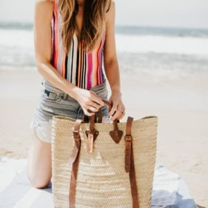 my beach bag essentials for a day at the beach with my kids