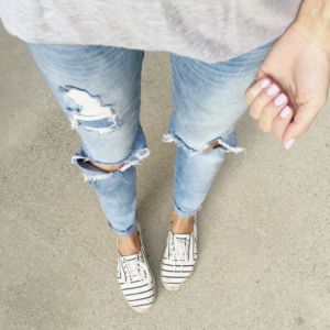 distressed jeans and sneakers