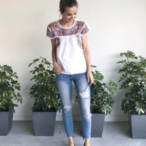 jeans and embroidered top