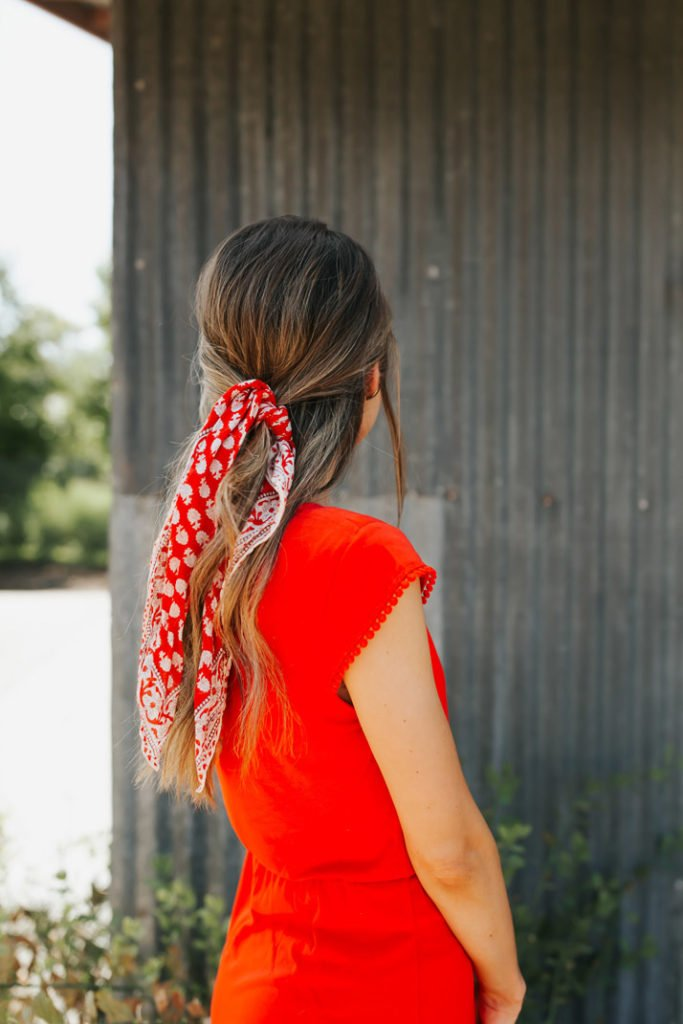 tie a bandana in your hair to make a simple summer outfit a little more special
