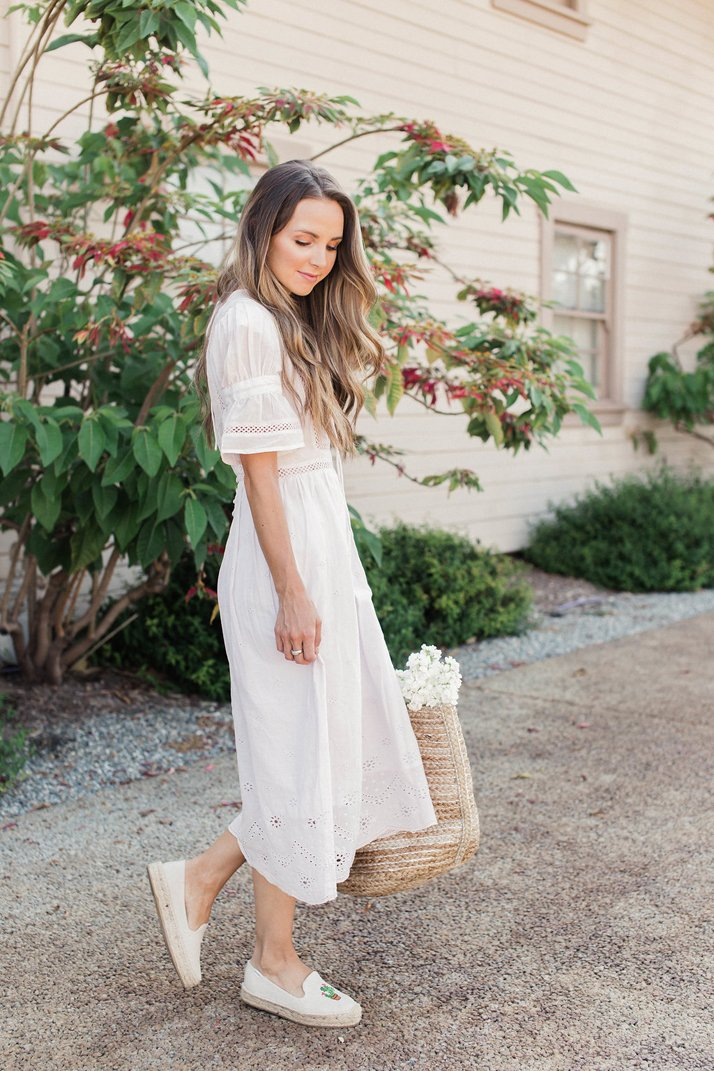 a midi dress and espadrille flats are a great choice for a date night outfit in the summer
