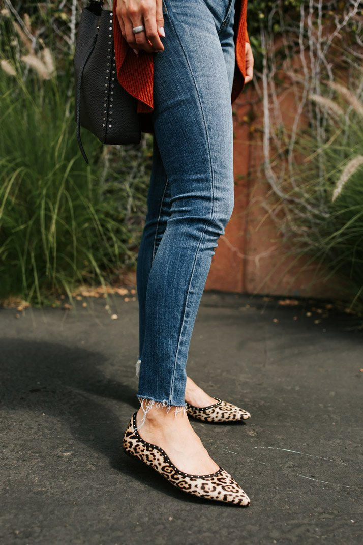 leopard flats and frayed hem jeans