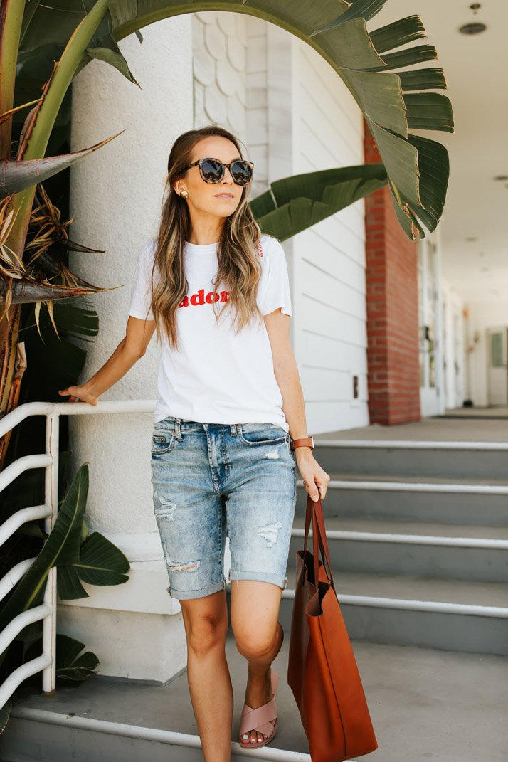 bermuda shorts and a graphic tee