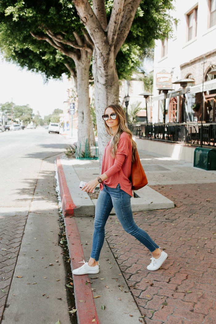 white sneakers with coral henley top