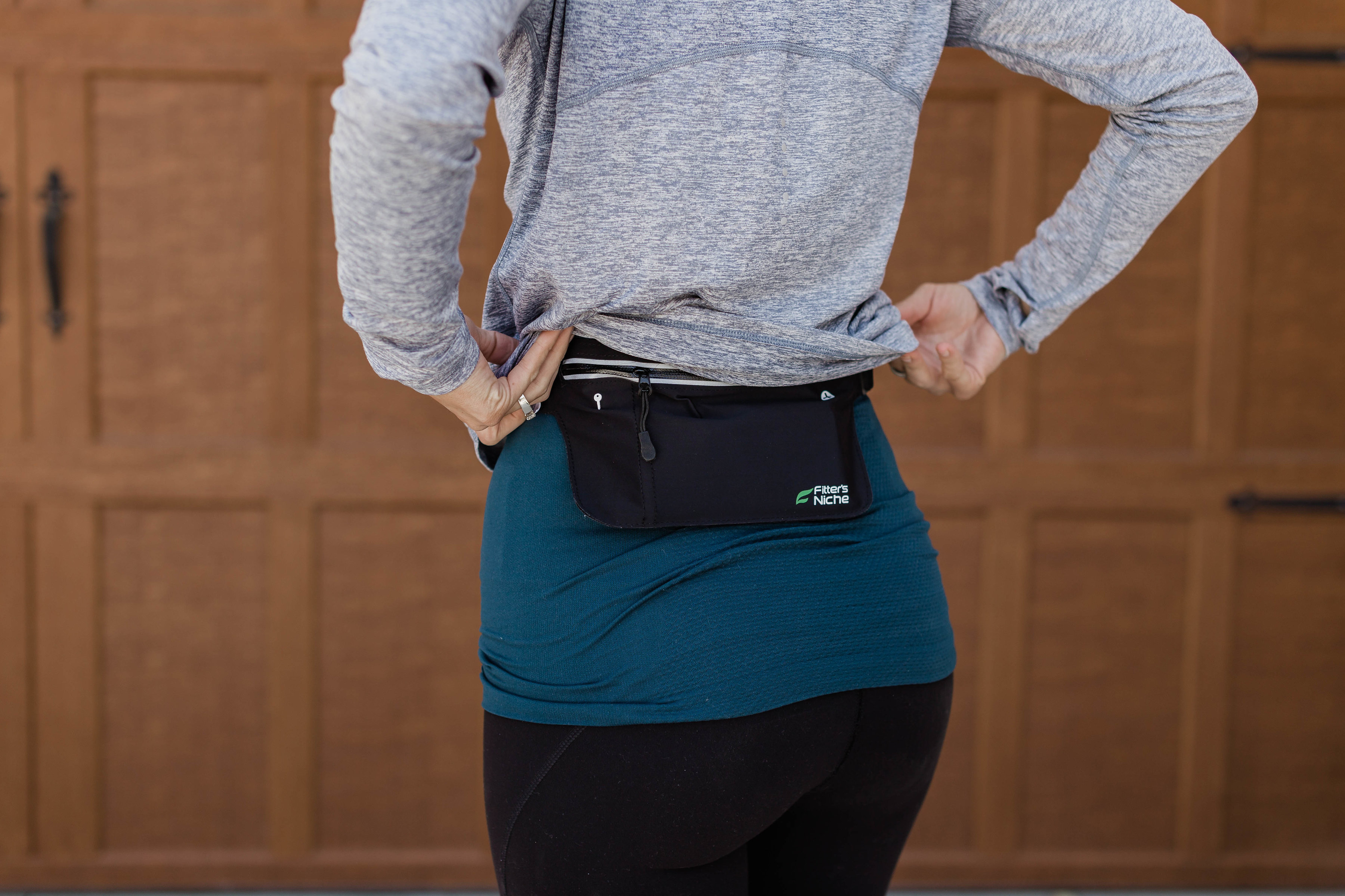 this little running pack tucks under your top and holds a phone and a key!