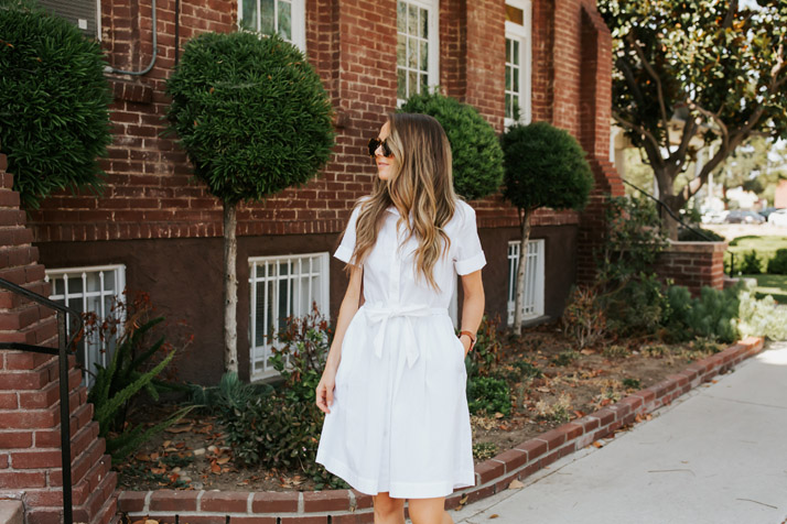 white shirt dress and sunglasses
