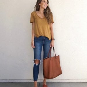 mustard yellow top and jeans