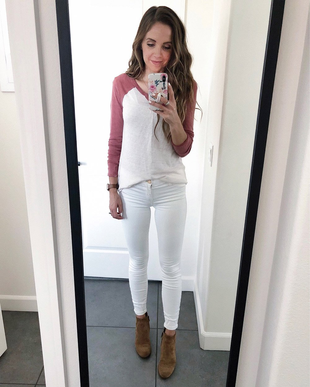 baseball tee and white jeans