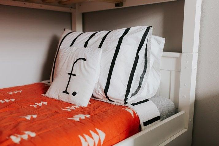 orange, black, and white bedding