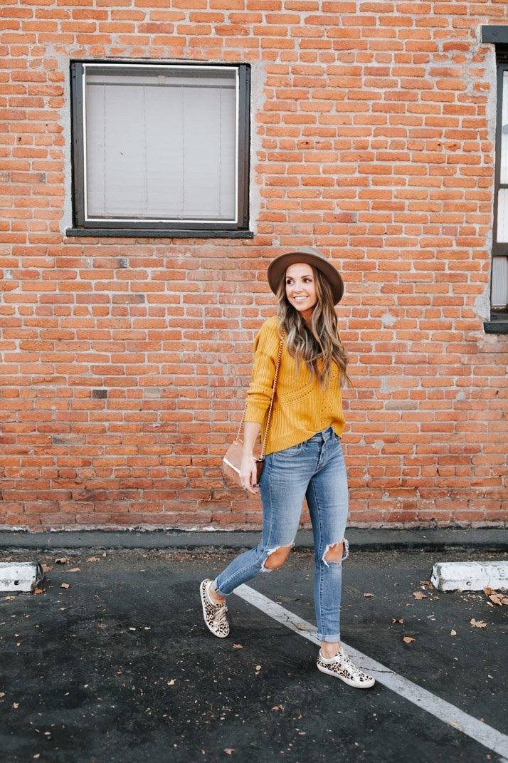 fall outfit with a mustard sweater
