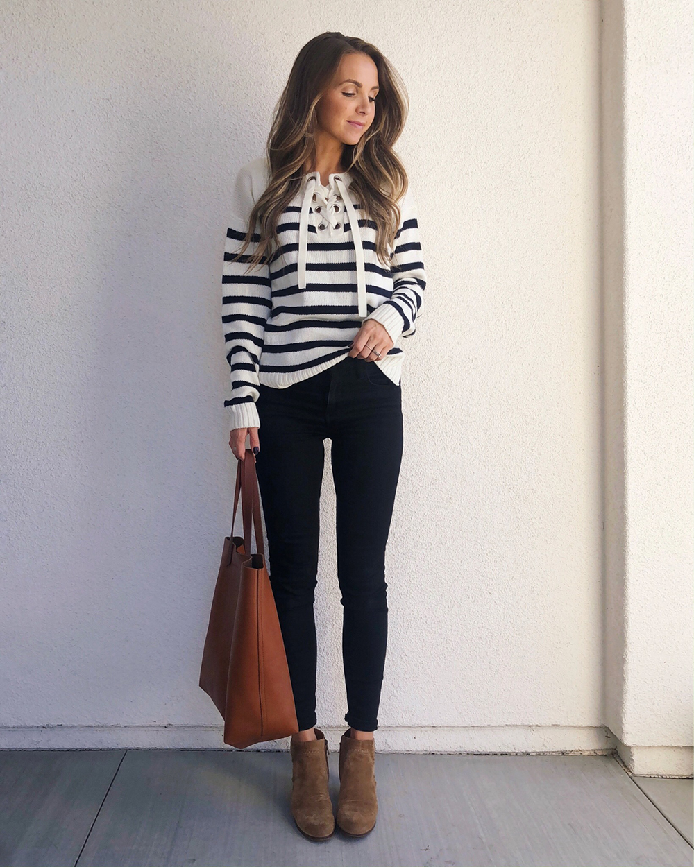 striped sweatshirt and black jeans