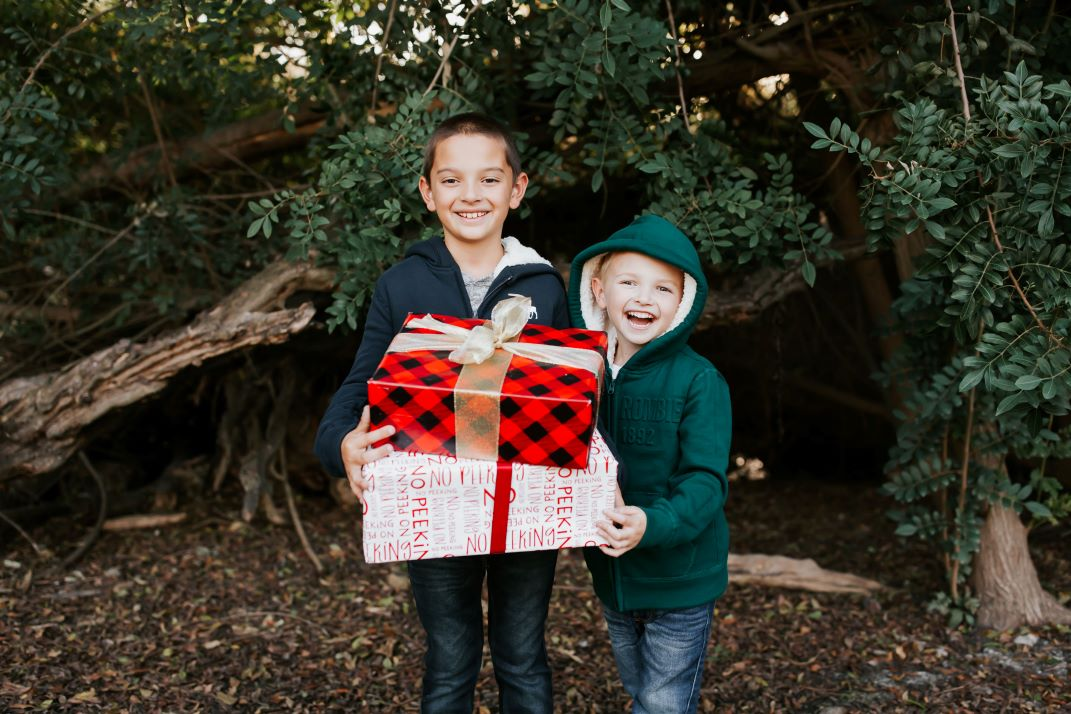 boys holding christmas presents wrapped