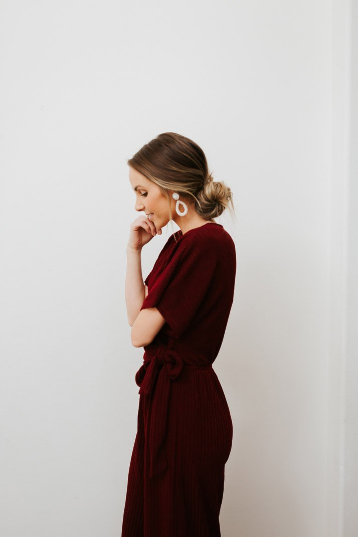 this burgundy jumpsuit is perfect for a holiday party!