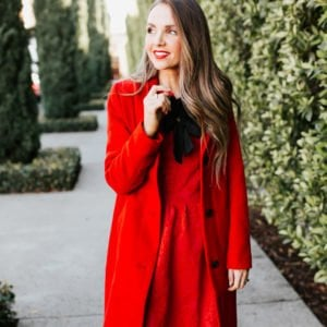 red dress with black neckline bows