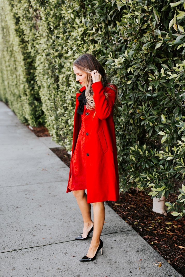 red dress with red coat and black heels