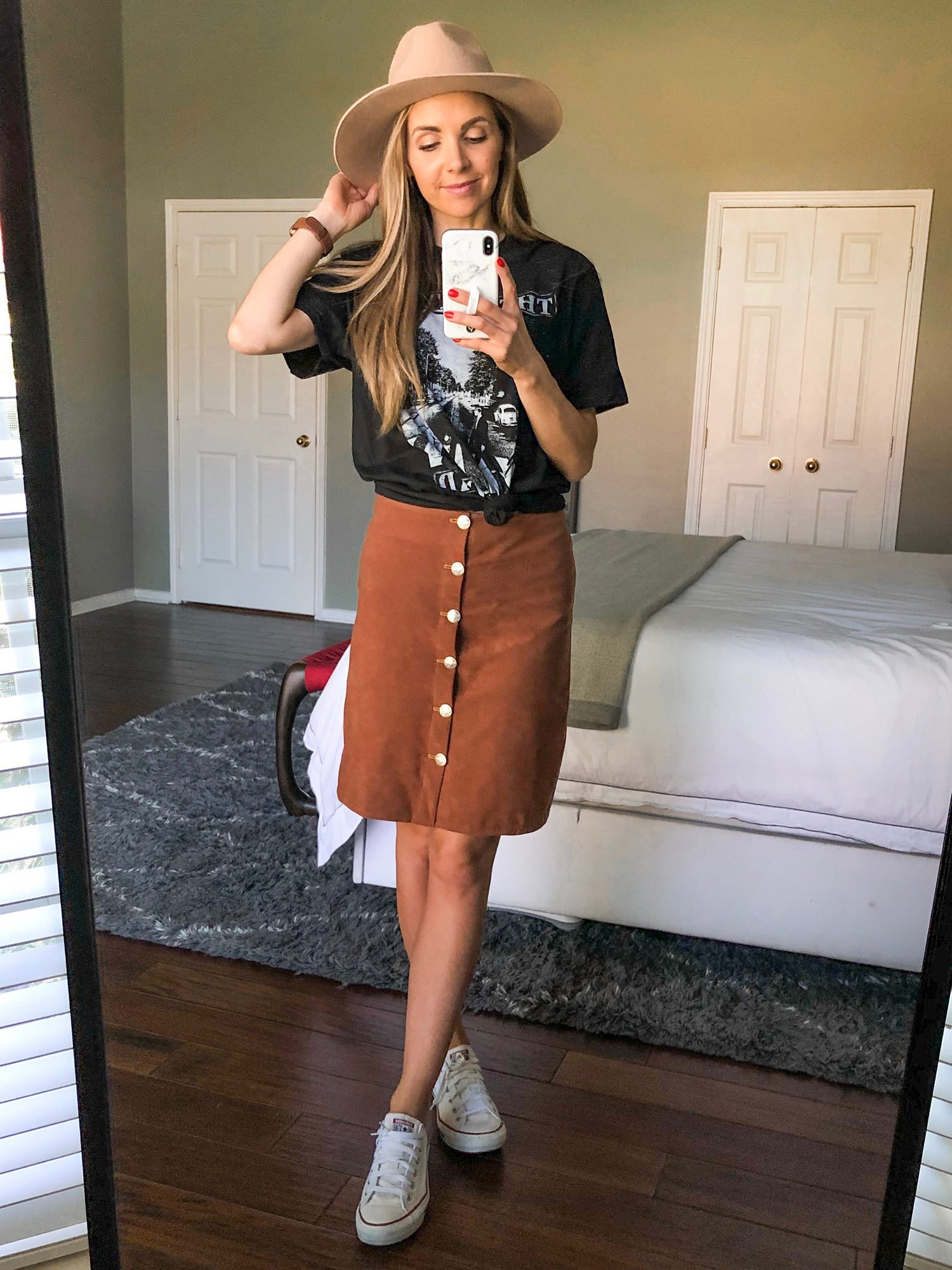 graphic tee and suede skirt
