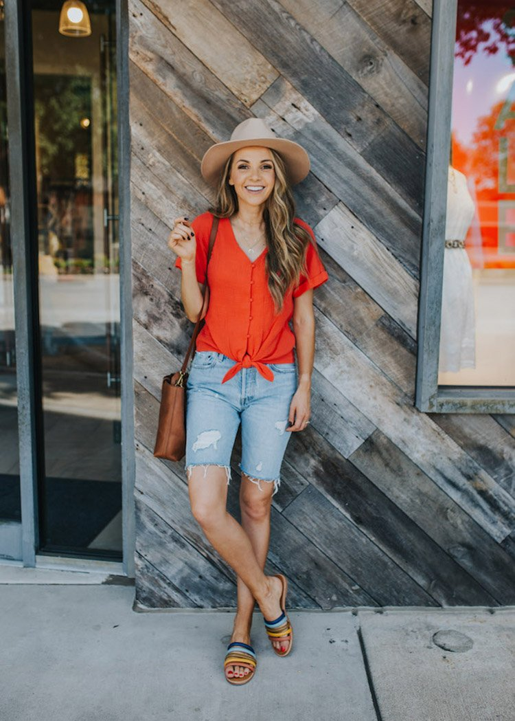 red top and bermuda shorts