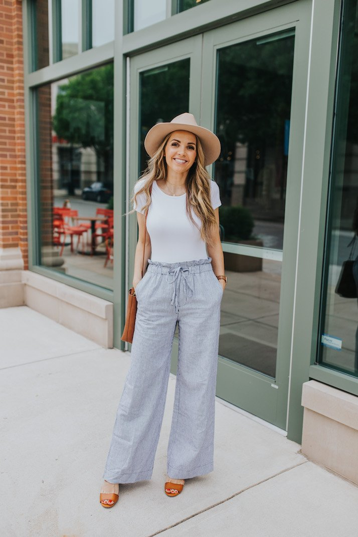 white bodysuit and striped linen pants