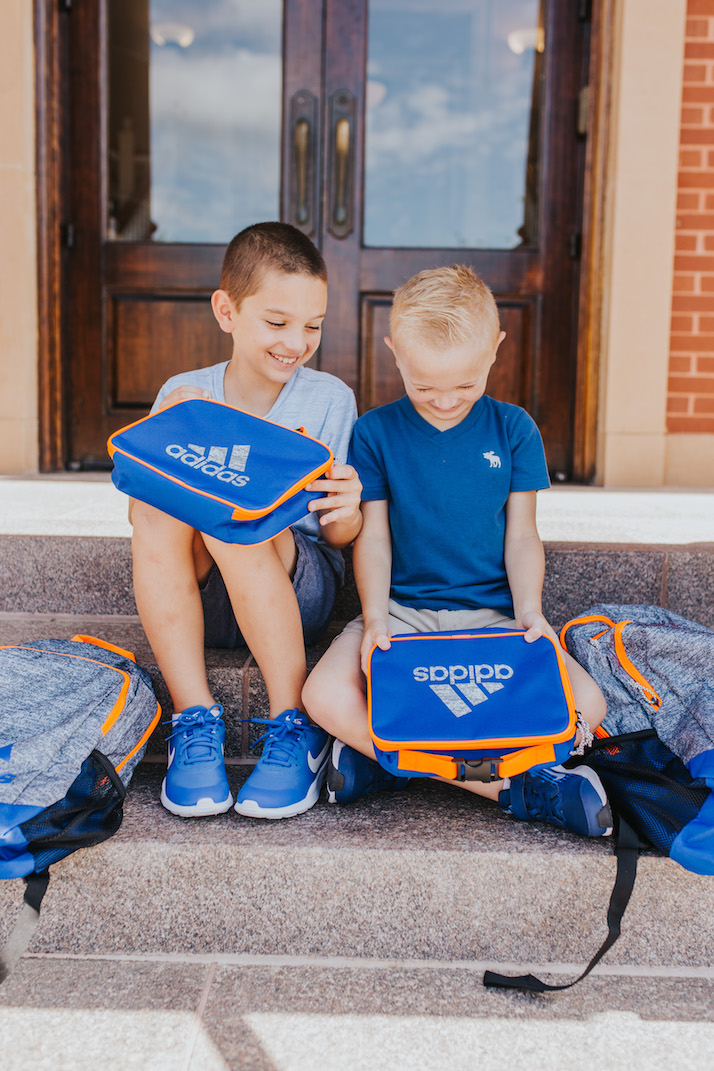 boys with blue lunchboxes