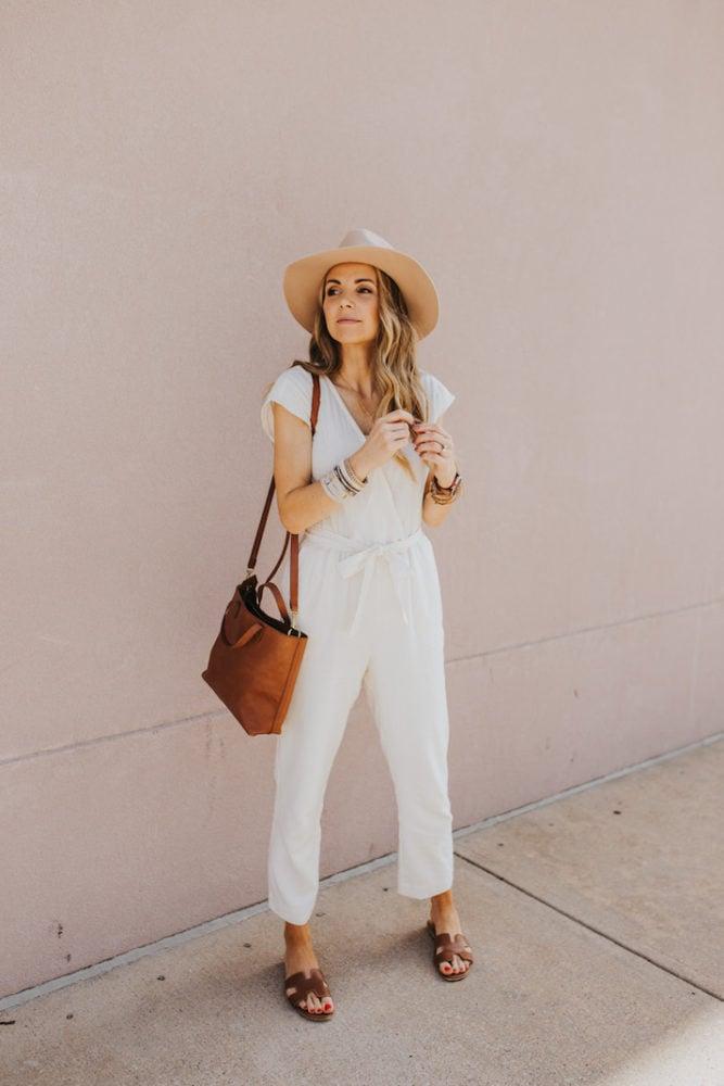 white jumpsuit with felt fedora hat