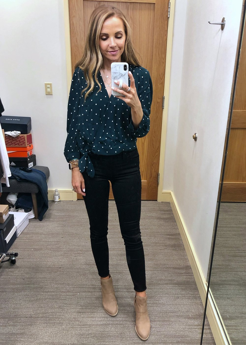 polka dot wrap top and black jeans
