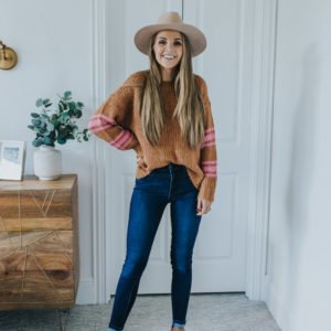 brown sweater with pink stripes tan fedora hat