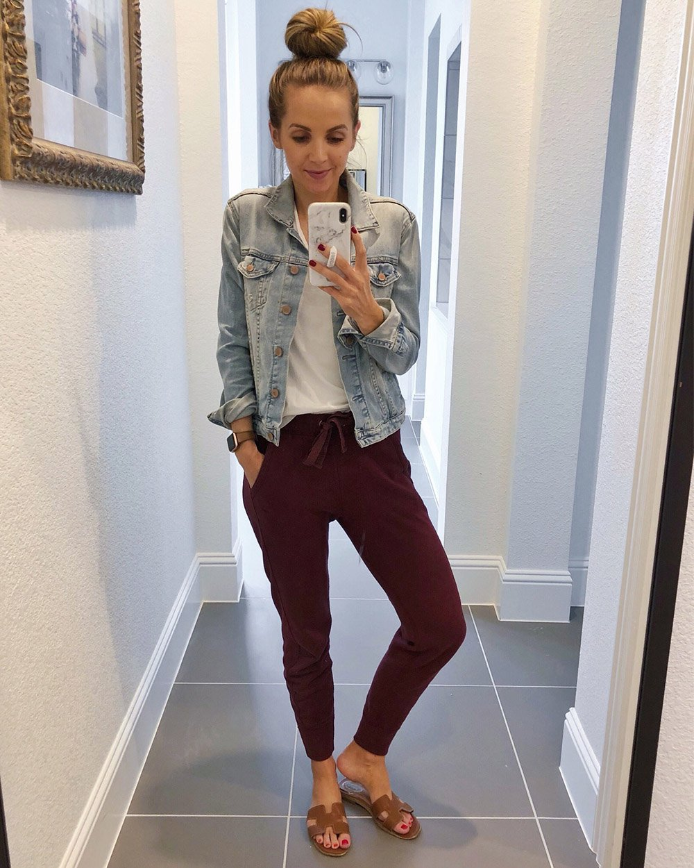 maroon sweatpants with denim jacket and white tee