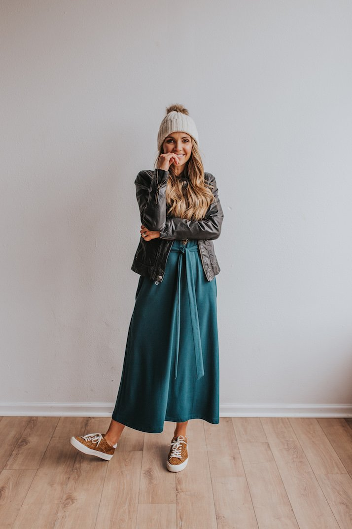 green midi dress with leopard sneakers and black leather jacket