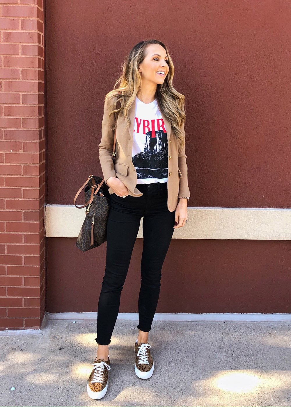 graphic tee with blazer and jeans