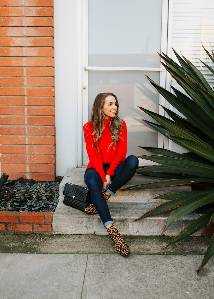 red turtleneck sweater with dark jeans and leopard booties