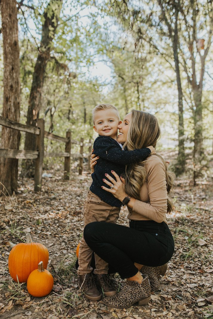 hugging mom and son with pumpkins