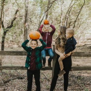 mom and boys with pumpkins on their heads