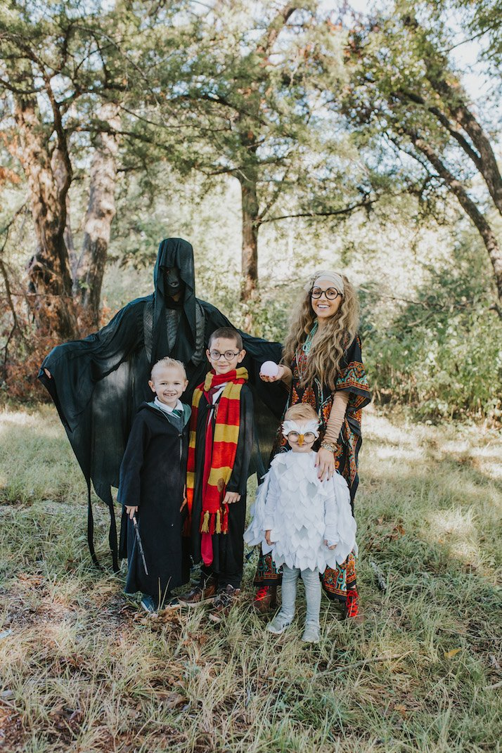 family harry potter halloween costume in the woods