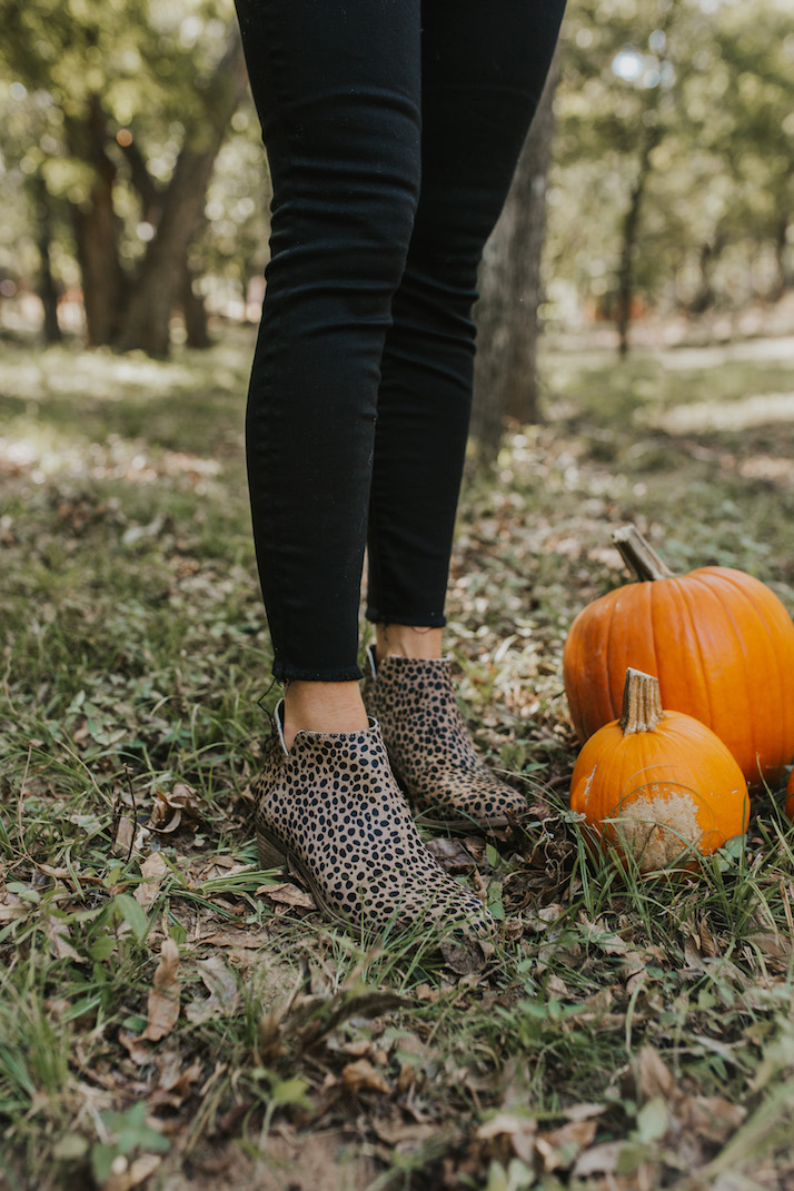leopard print ankle boots and black jeans