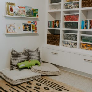 playroom floor pillows and floating bookshelves