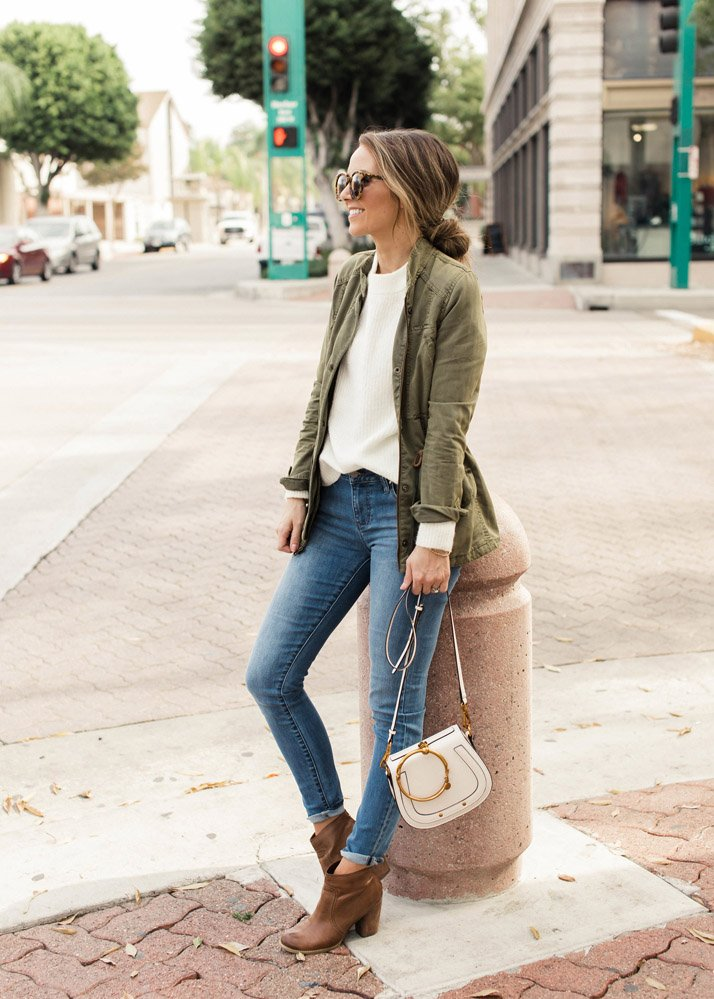 olive jacket with cream sweater and jeans - how to wear jackets in the fall