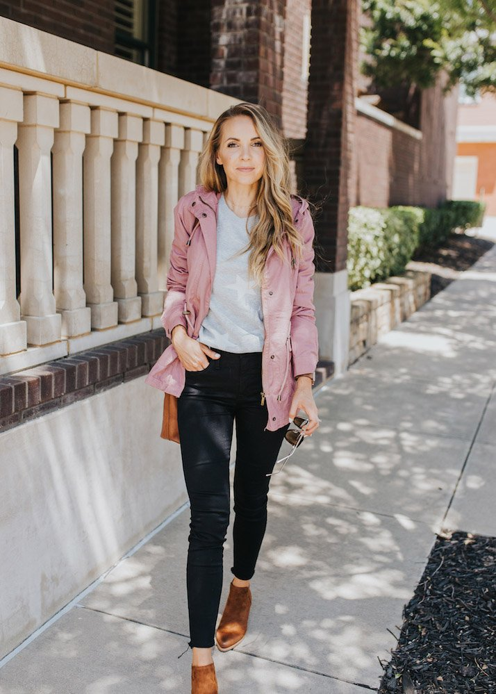 pink anorak jacket and black jeans