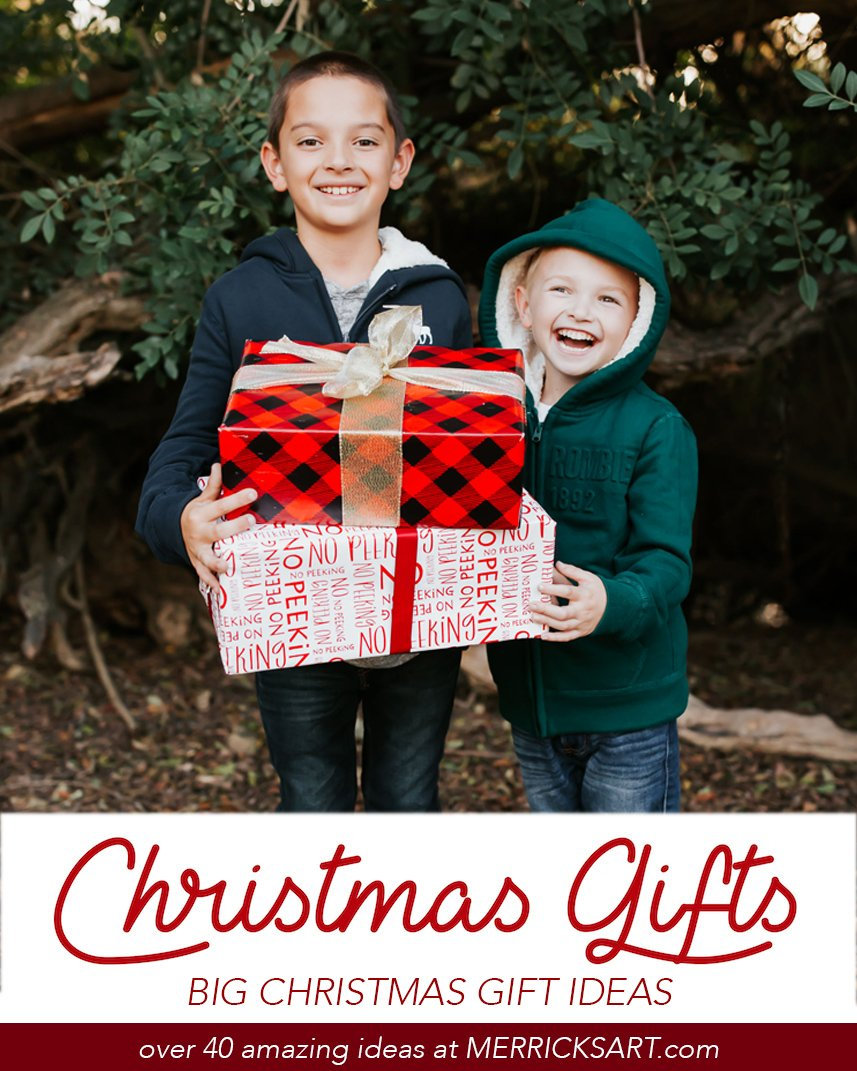 boys holding wrapped presents brothers
