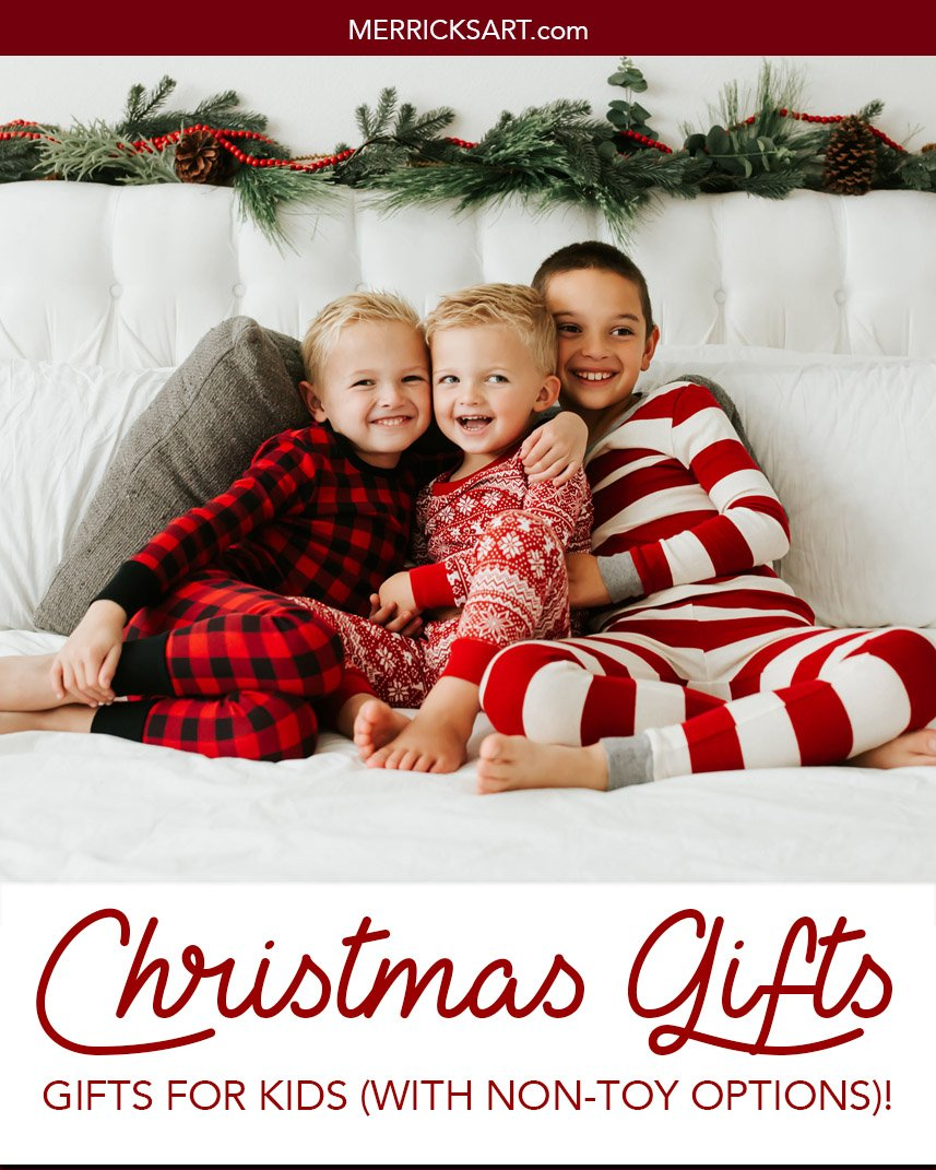boys on a white bed with christmas pajamas