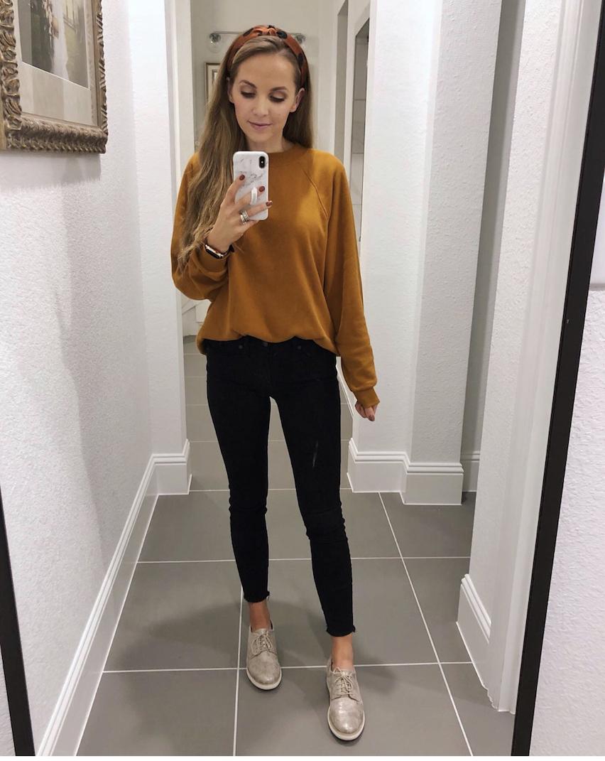 caramel sweatshirt and black jeans